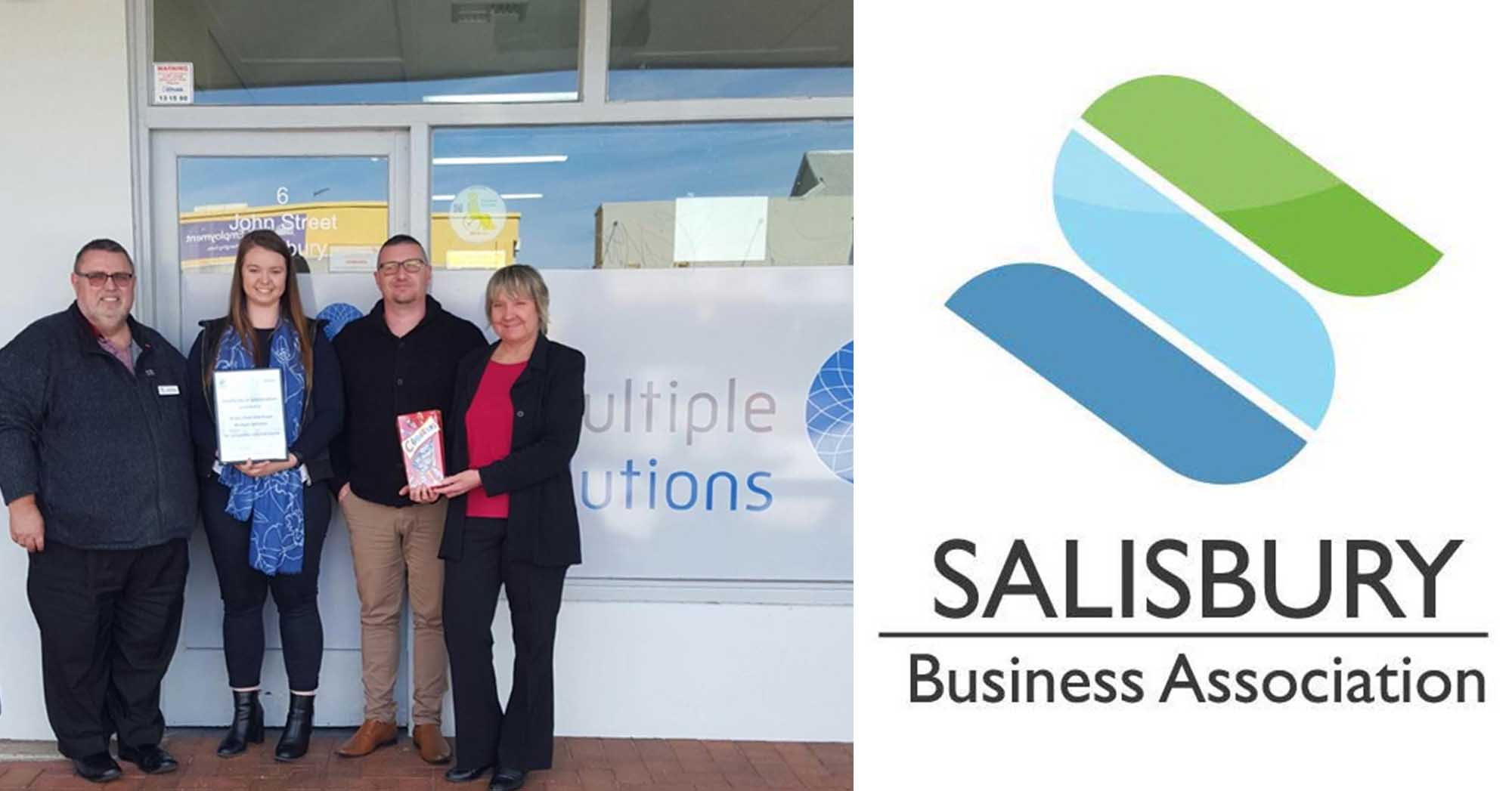 Photo of Sarah, Adam and Linda receiving certificate from Salisbury Business Trades Association